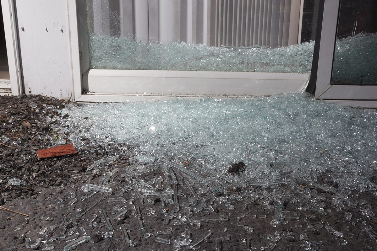 Glass from a shattered sliding glass door a home invader broke